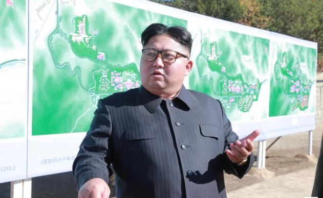 North Korea's Kim inspects newly developed 'tactical' weapon, releases U.S. prisoner