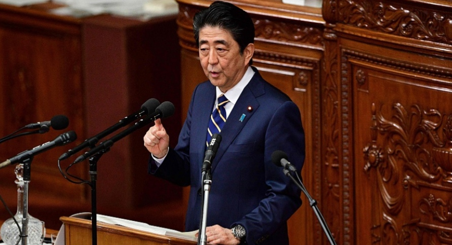 Japan's Abe says willing to meet with Kim Jong Un