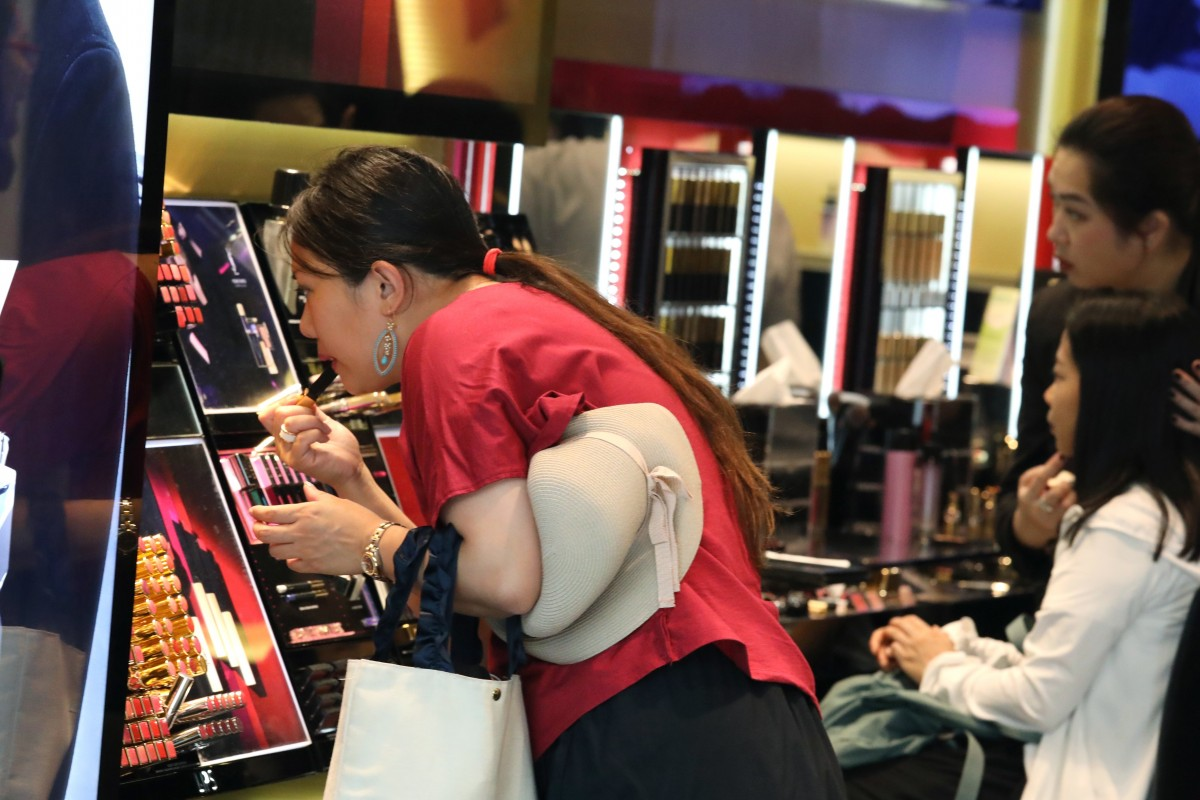China cuts tax on personal items bought overseas in move to boost consumption