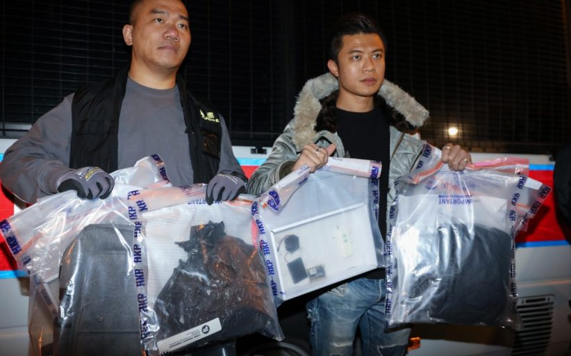 Bomb disposal officers in Hong Kong defuse two home-made devices containing 10kg of explosives in school grounds