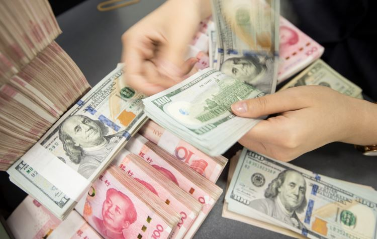Goldman Sachs sees the Chinese yuan strengthening to 6.70 against the dollar in the next 12 months